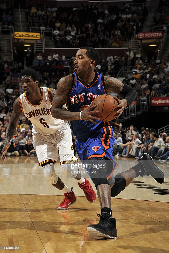 <a gi-track='captionPersonalityLinkClicked' href=/galleries/search?phrase=J.R.+Smith&family=editorial&specificpeople=201766 ng-click='$event.stopPropagation()'>J.R. Smith</a> #8 of the New York Knicks drives to the basket trailed by <a gi-track='captionPersonalityLinkClicked' href=/galleries/search?phrase=Manny+Harris&family=editorial&specificpeople=4683139 ng-click='$event.stopPropagation()'>Manny Harris</a> #6 of the Cleveland Cavaliers at The Quicken Loans Arena on April 20, 2012 in Cleveland, Ohio.