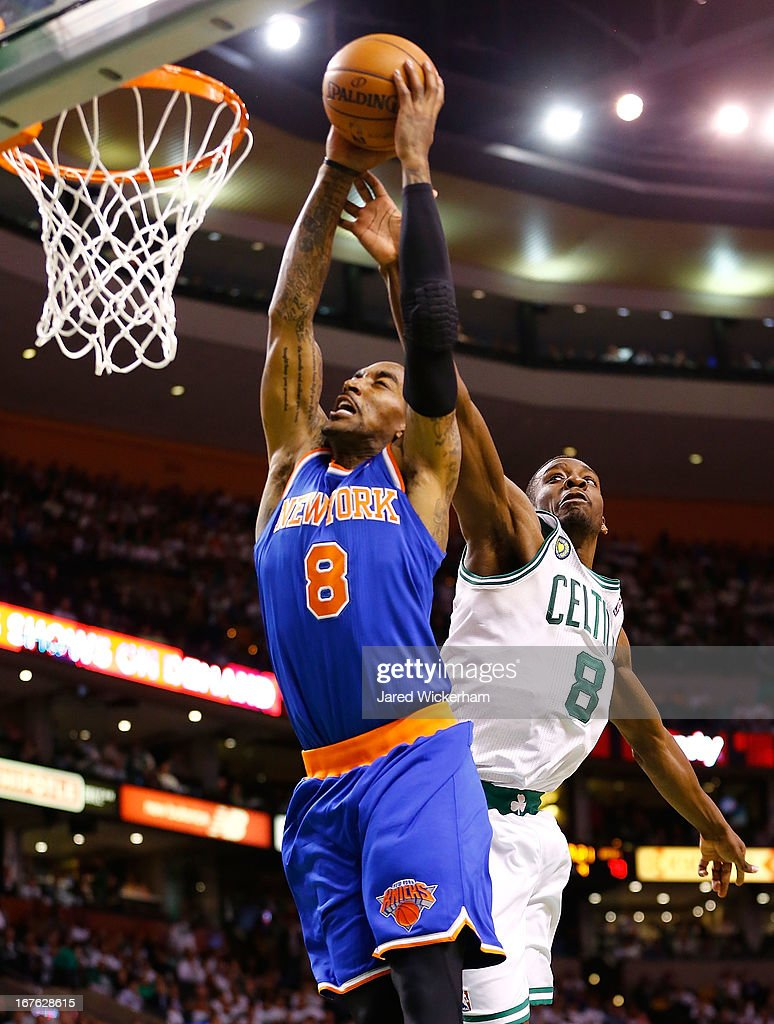 J.R. Smith #8 of the New York Knicks dunks the ball over Jeff Green #8 of the Boston Celtics during Game Three of the Eastern Conference Quarterfinals of the 2013 NBA Playoffs on April 26, 2013 at TD Garden in Boston, Massachusetts.