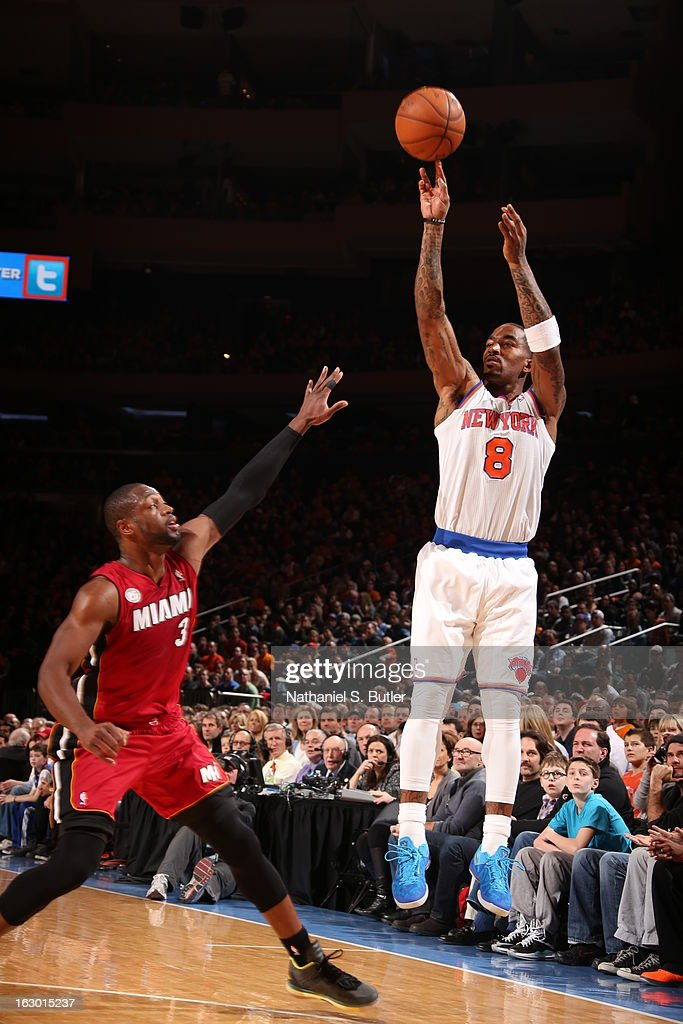J.R. Smith #8 of the New York Knicks Dwyane Wade #3 of the Miami Heat on March 3, 2013 at Madison Square Garden in New York City.