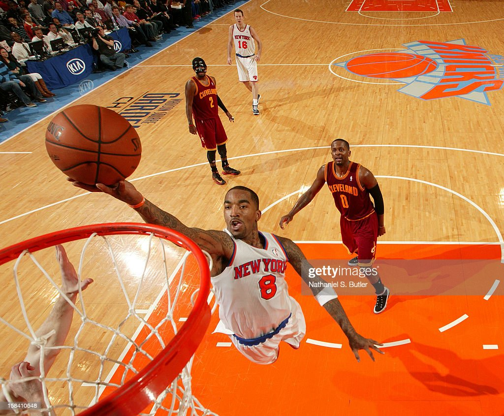 J.R. Smith #8 of the New York Knicks goes to the basket against Cleveland Cavaliers during game on December 15, 2012 at Madison Square Garden in New York City.