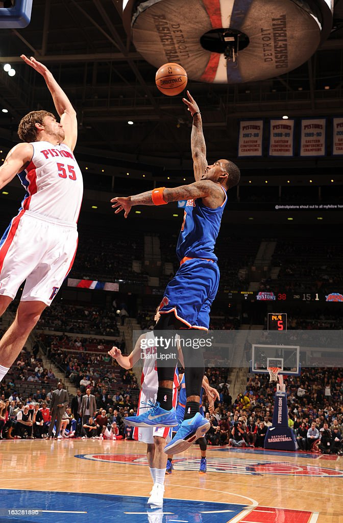 J.R. Smith #8 of the New York Knicks goes to the basket against Viacheslav Kravtsov #55 of the Detroit Pistons during the game between the Detroit Pistons and the Atlanta Hawks on March 6, 2013 at The Palace of Auburn Hills in Auburn Hills, Michigan.