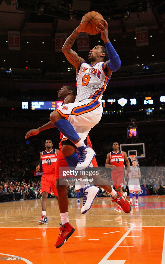 <a gi-track='captionPersonalityLinkClicked' href=/galleries/search?phrase=J.R.+Smith&family=editorial&specificpeople=201766 ng-click='$event.stopPropagation()'>J.R. Smith</a> #8 of the New York Knicks goes to the basket during the game against the Washington Wizards on April 13, 2012 at Madison Square Garden in New York City.
