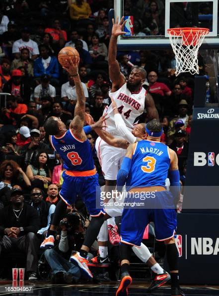 R Smith of the New York Knicks goes up for the shot against Ivan Johnson of the Atlanta Hawks attempts to block it on April 3 2013 at Philips Arena...