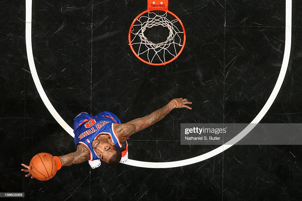 J.R. Smith #8 of the New York Knicks grabs a rebound against the Brooklyn Nets on December 11, 2012 at the Barclays Center in the Brooklyn borough of New York City.