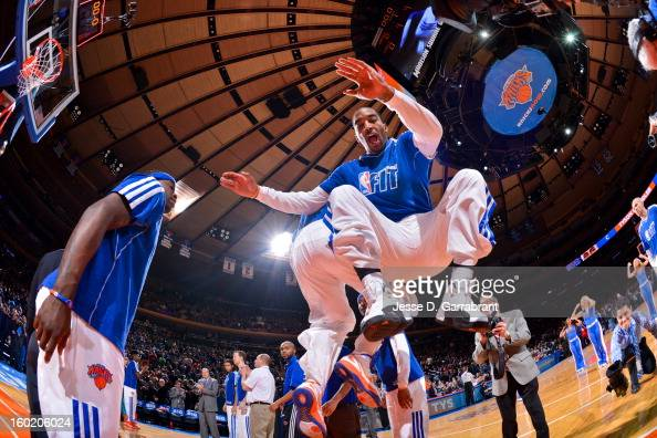 JR Smith of the New York Knicks greets teammates before playing against the Atlanta Hawks at Madison Square Garden on January 27 2013 in New York New...