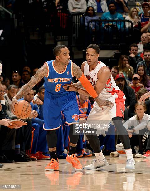 JR Smith of the New York Knicks handles the ball against DeMar DeRozan of the Toronto Raptors on April 11 2014 at the Air Canada Centre in Toronto...
