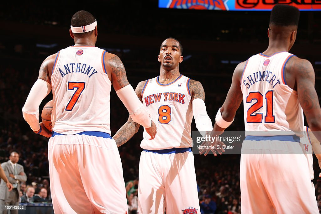 J.R. Smith #8 of the New York Knicks high-fives teammates Carmelo Anthony #7 and Iman Shumpert #21 in a game against the Boston Celtics on March 31, 2013 at Madison Square Garden in New York City.