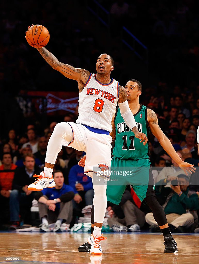 J.R. Smith #8 of the New York Knicks in action against Courtney Lee #11 of the Boston Celtics at Madison Square Garden on March 31, 2013 in New York City. The Knicks defeated the Celtics 108-89.