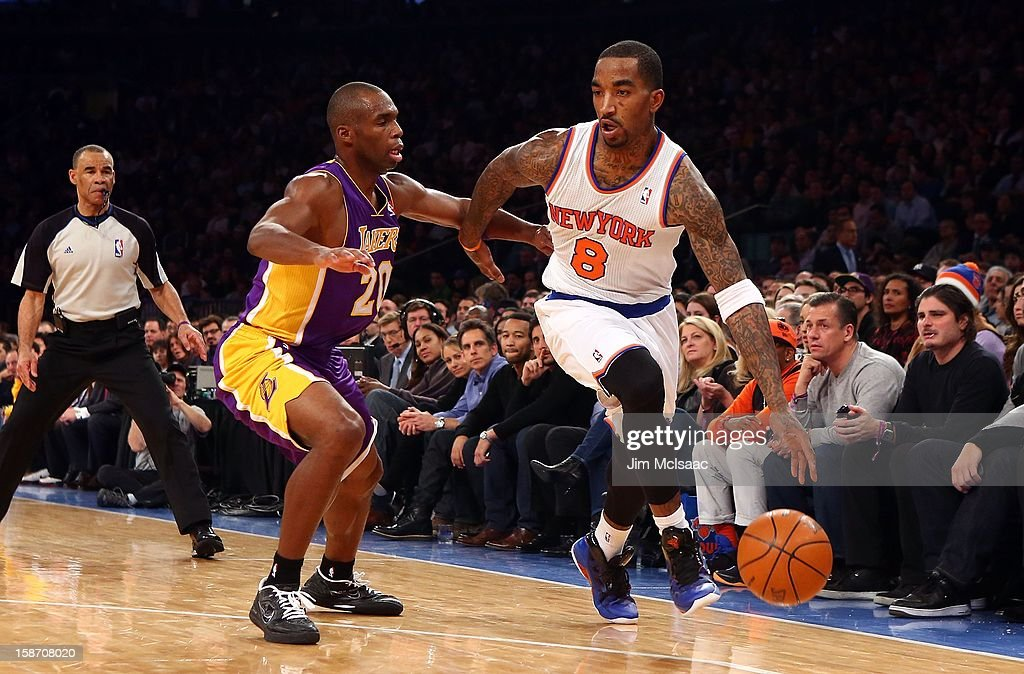 J.R. Smith #8 of the New York Knicks in action against Jodie Meeks #20 of the Los Angeles Lakers at Madison Square Garden on December 13, 2012 in New York City. The Knicks defeated the Lakers 116-107.
