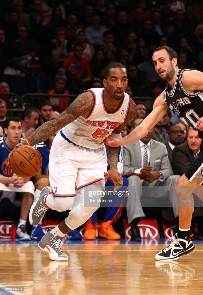 J.R. Smith #8 of the New York Knicks in action against Manu Ginobili #20 of the San Antonio Spurs at Madison Square Garden on January 3, 2013 in New York City. The Knicks defeated the Spurs 100-83.