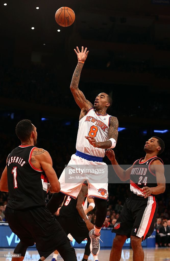 J.R. Smith #8 of the New York Knicks in action against Ronnie Price #24 and Jared Jeffries #1 of the Portland Trail Blazers at Madison Square Garden on January 1, 2013 in New York City. The Trail Blazers defeated the Knicks 105-100.