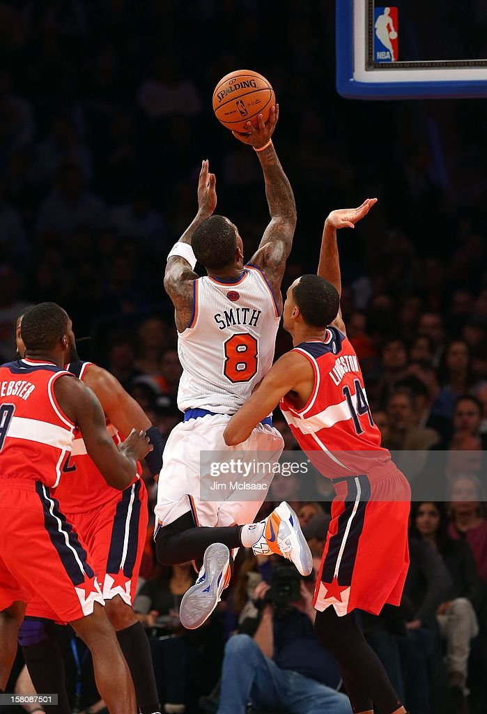 J.R. Smith #8 of the New York Knicks in action against Shaun Livingston #14 of the Washington Wizards at Madison Square Garden on November 30, 2012 in New York City. The Knicks defeated the Wizards 108-87.