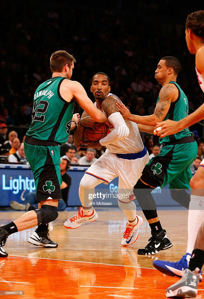 J.R. Smith #8 of the New York Knicks in action against Shavlik Randolph #42 and Courtney Lee #11 of the Boston Celtics at Madison Square Garden on March 31, 2013 in New York City. The Knicks defeated the Celtics 108-89.