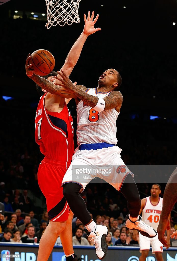 J.R. Smith #8 of the New York Knicks in action against Zaza Pachulia #27 of the Atlanta Hawks at Madison Square Garden on January 27, 2013 in New York City. The Knicks defeated the Hawks 106-104.