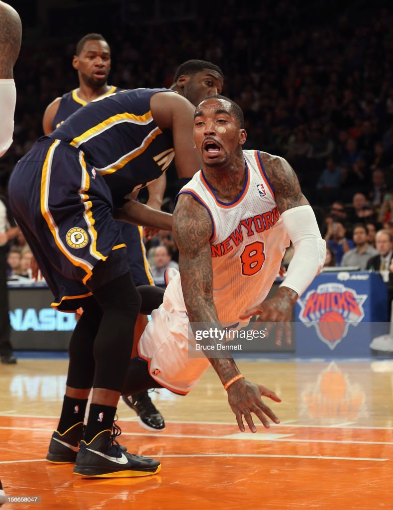 J.R. Smith #8 of the New York Knicks is taken off his feet in the game against the Indiana Pacers at Madison Square Garden on November 18, 2012 in New York City.