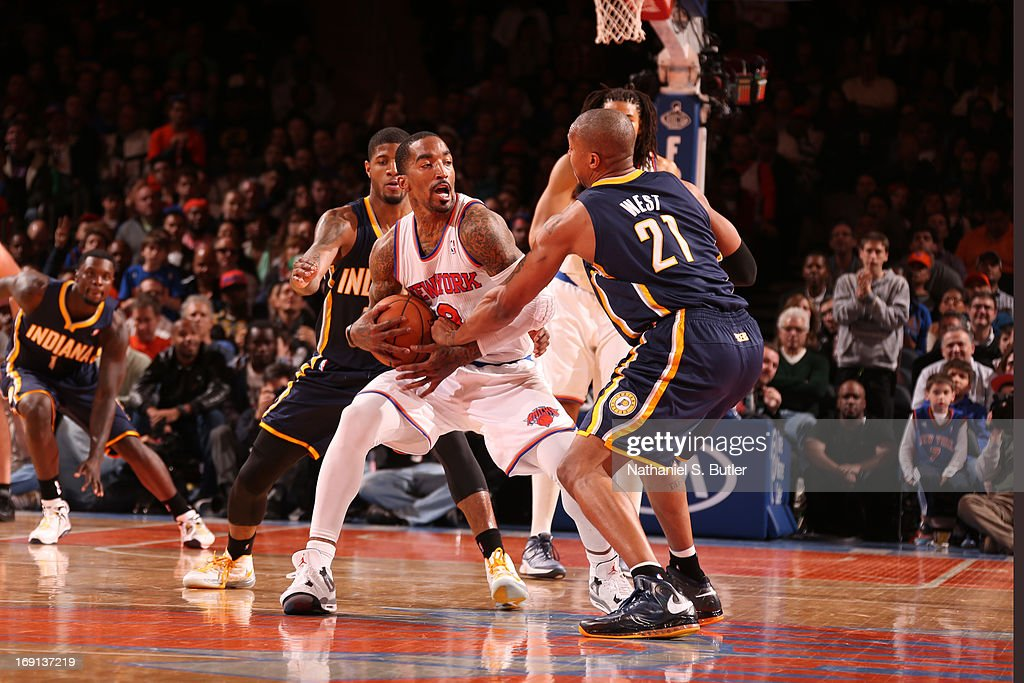 <a gi-track='captionPersonalityLinkClicked' href=/galleries/search?phrase=J.R.+Smith&family=editorial&specificpeople=201766 ng-click='$event.stopPropagation()'>J.R. Smith</a> #8 of the New York Knicks keeps control of the ball against David West #21 of the Indiana Pacers on April 14, 2013 at Madison Square Garden in New York City.