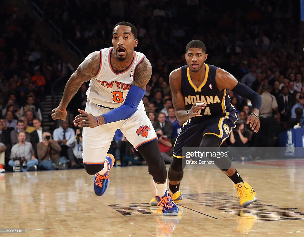 J.R. Smith #8 of the New York Knicks keeps his eyes on the ball against the Indiana Pacers at Madison Square Garden on November 20, 2013 in New York City.