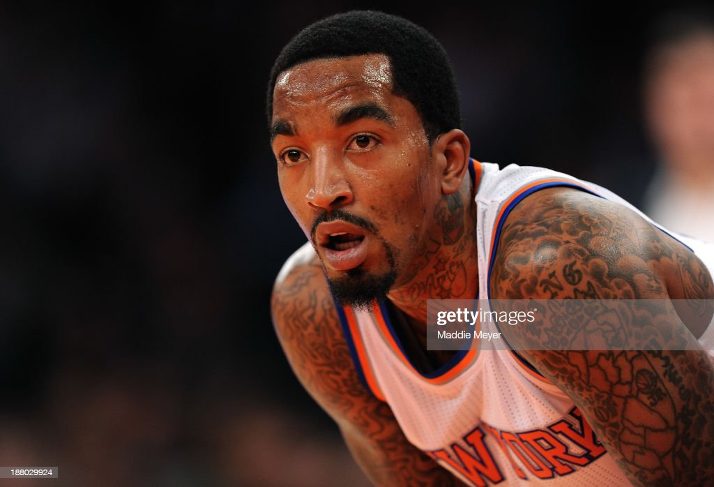 J.R. Smith #8 of the New York Knicks looks on during the first half against the Houston Rockets at Madison Square Garden on November 14, 2013 in New York City. The Rockets defeat the Knicks 109-106.