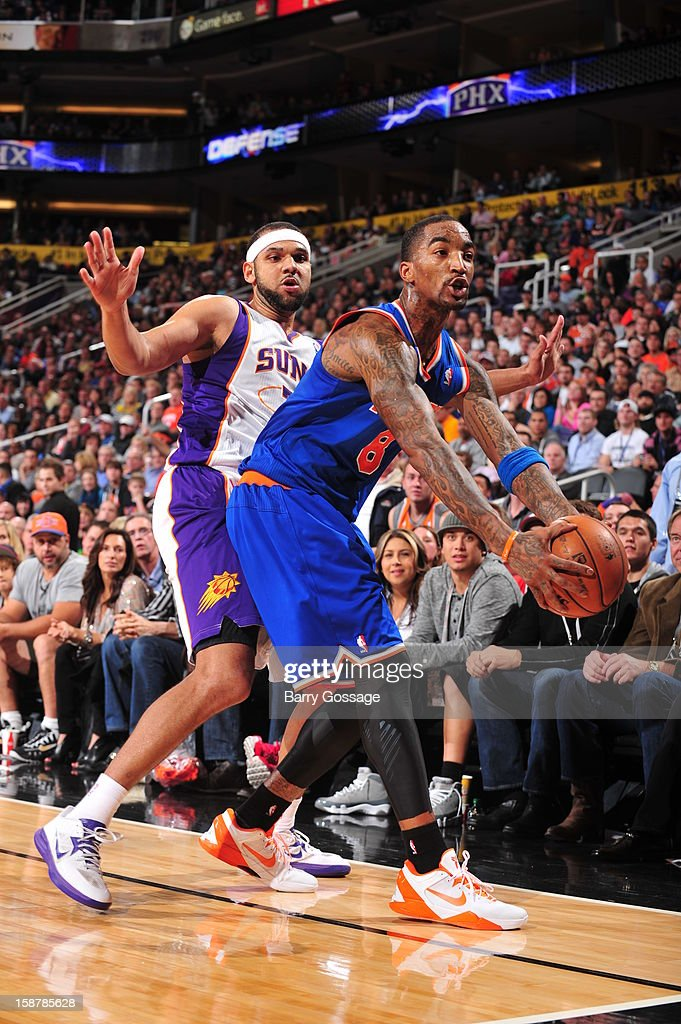 <a gi-track='captionPersonalityLinkClicked' href=/galleries/search?phrase=J.R.+Smith&family=editorial&specificpeople=201766 ng-click='$event.stopPropagation()'>J.R. Smith</a> #8 of the New York Knicks looks to shoot against the Phoenix Suns on December 26, 2012 at U.S. Airways Center in Phoenix, Arizona.