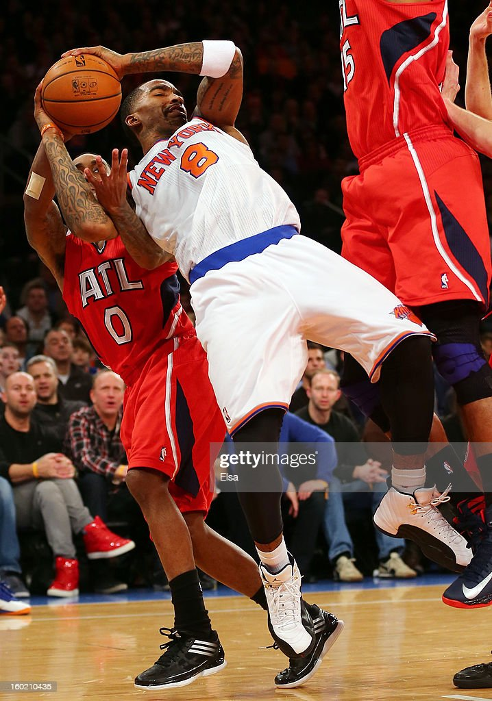J.R. Smith #8 of the New York Knicks loses the ball to Jeff Teague #0 of the Atlanta Hawks on January 27, 2013 at Madison Square Garden in New York City. The New York Knicks defeated the Atlanta Hawks 106-104.