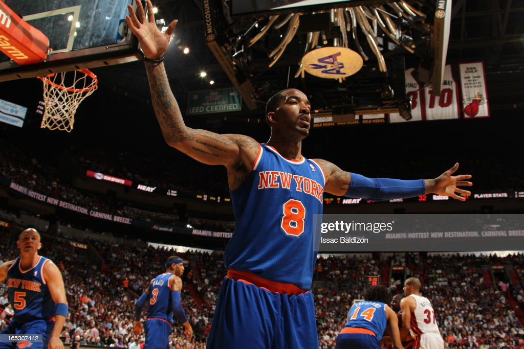 J.R. Smith #8 of the New York Knicks plays tight defense against the Miami Heat during a game on April 2, 2013 at American Airlines Arena in Miami, Florida.