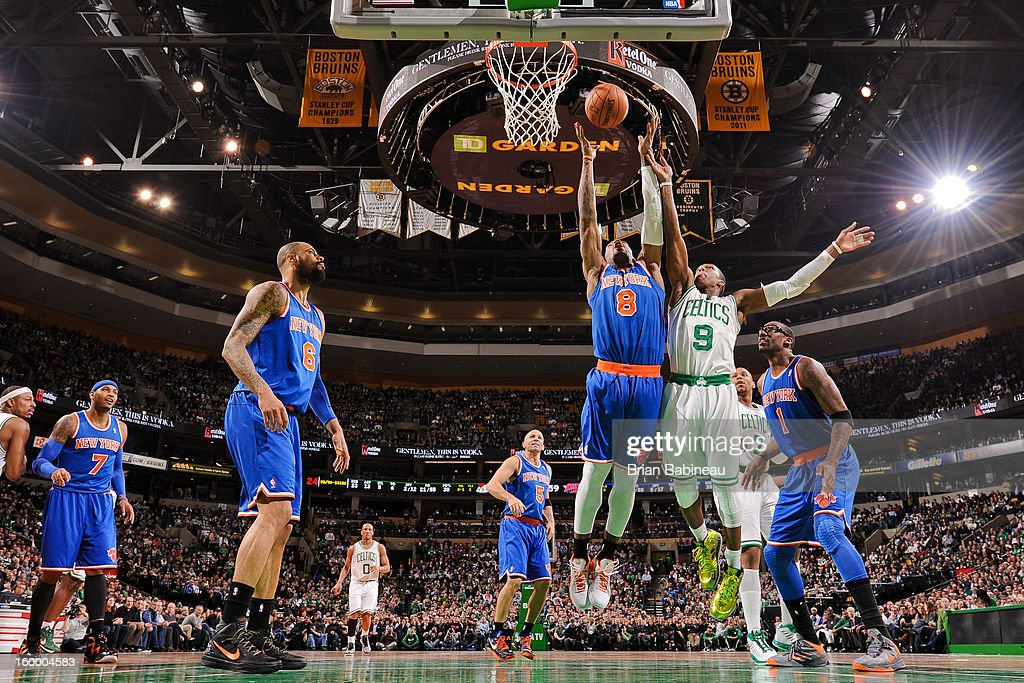 J.R. Smith #8 of the New York Knicks reaches for a rebound against Rajon Rondo #9 of the Boston Celtics on January 24, 2013 at the TD Garden in Boston, Massachusetts.