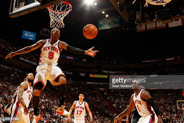 R Smith of the New York Knicks reaches for a rebound during the game against the Miami Heat on February 23 2012 at American Airlines Arena in Miami...
