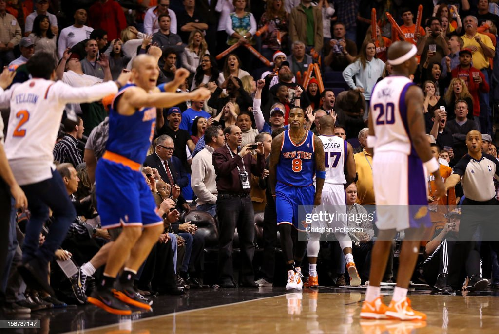J.R. Smith #8 of the New York Knicks reacts after hitting the game winning basket as time expired to beat the Phoenix Suns 99-97 in the NBA game at US Airways Center on December 26, 2012 in Phoenix, Arizona.