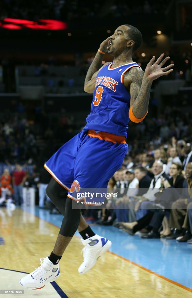 J.R. Smith #8 of the New York Knicks reacts after shooting the game winning shot as time runs expires to defeat the Charlotte Bobcats 100-98 during their game at Time Warner Cable Arena on December 5, 2012 in Charlotte, North Carolina.