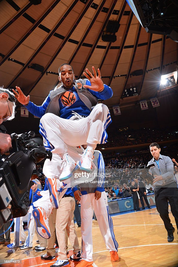 J.R. Smith #8 of the New York Knicks runs out before the game against the Philadelphia 76ers on February 24, 2013 at Madison Square Garden in New York City, New York.