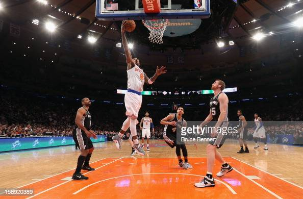 R Smith of the New York Knicks scores a second half basket against the San Antonio Spurs at Madison Square Garden on January 3 2013 in New York City...