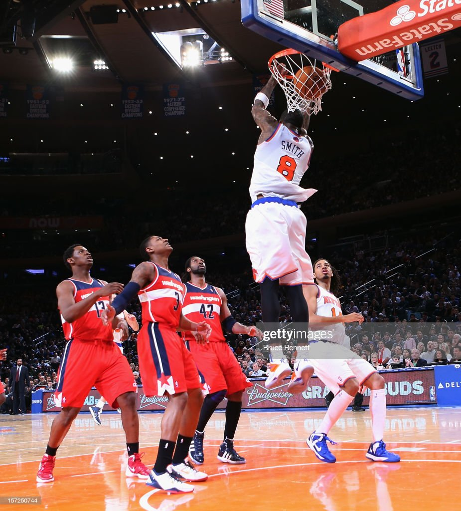 R Smith of the New York Knicks scores two against the Washington Wizards with a reverse dunk in the fourth quarter at Madison Square Garden on...