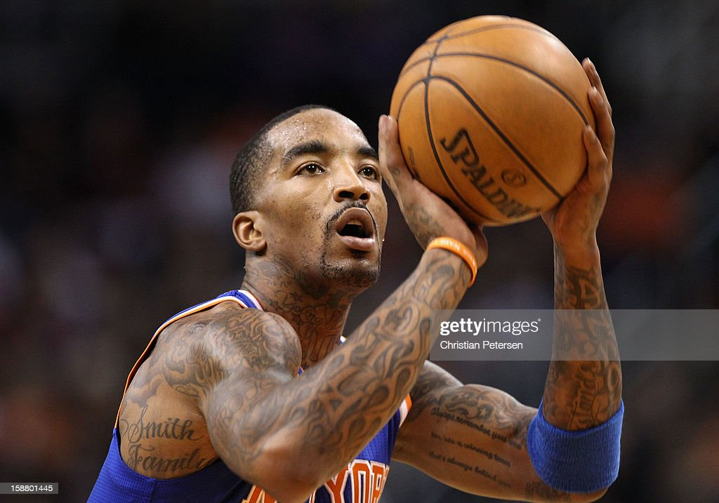 J.R. Smith #8 of the New York Knicks shoots a free throw shot during the NBA game against the Phoenix Suns at US Airways Center on December 26, 2012 in Phoenix, Arizona. The Knicks defeated the Suns 99-97.