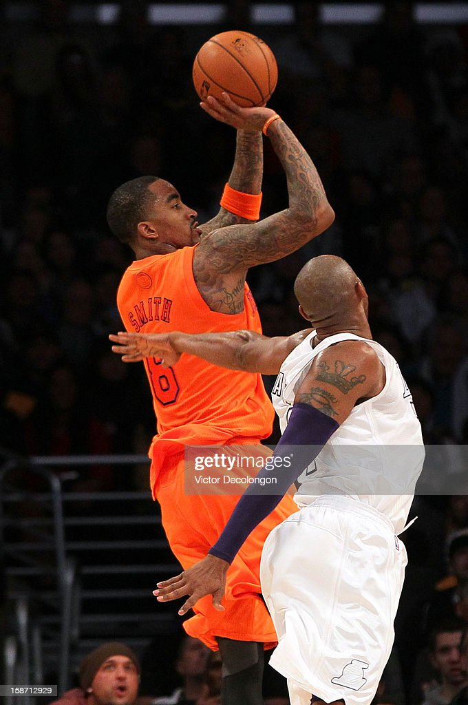 J.R. Smith #8 of the New York Knicks shoots a jump shot against Kobe Bryant #24 of the Los Angeles Lakers in the first half during the NBA game at Staples Center on December 25, 2012 in Los Angeles, California.