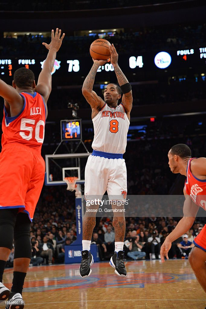 J.R. Smith #8 of the New York Knicks shoots a jumper while Lavoy Allen #50 of the Philadelphia 76ers trys to block the shot on November 4, 2012 at Madison Square Garden in New York City.