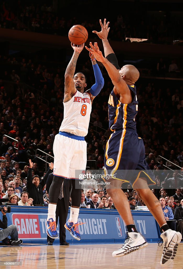 J.R. Smith #8 of the New York Knicks shoots against David West #21 of the Indiana Pacers during a game at Madison Square Garden in New York City on November 20, 2013.