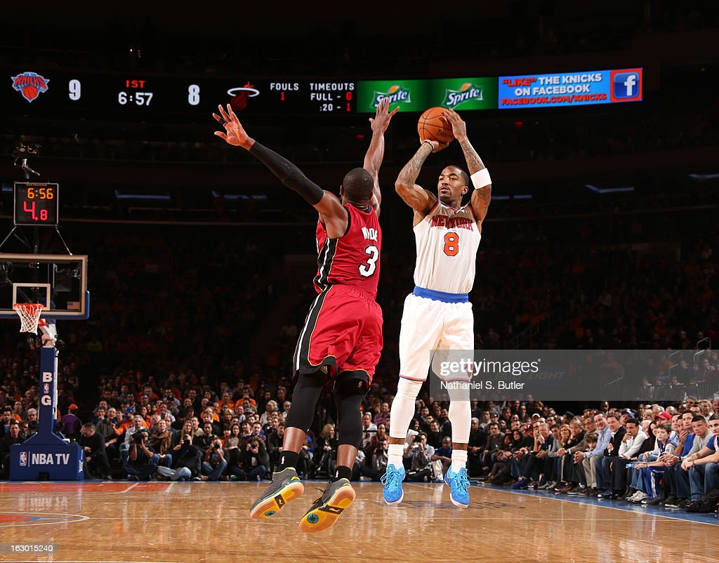 J.R. Smith #8 of the New York Knicks shoots against Dwyane Wade #3 of the Miami Heat on March 3, 2013 at Madison Square Garden in New York City.