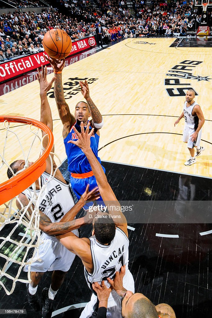 J.R. Smith #8 of the New York Knicks shoots against Kawhi Leonard #2 of the San Antonio Spurs on November 15, 2012 at the AT&T Center in San Antonio, Texas.