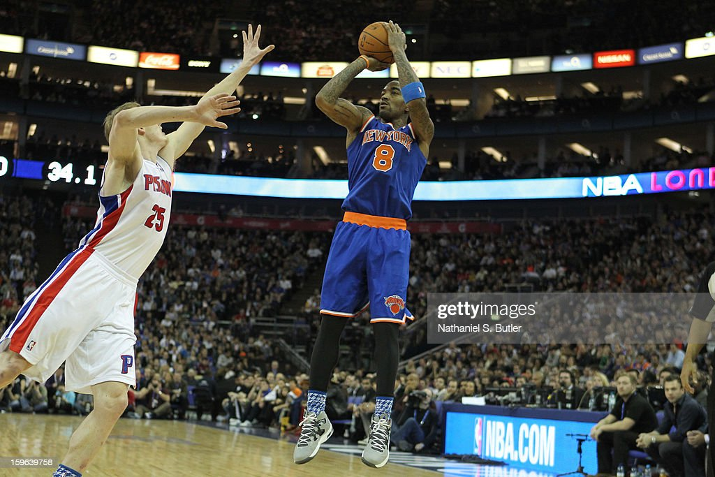 J.R. Smith #8 of the New York Knicks shoots against Kyle Singler #25 of the Detroit Pistons during a game between the New York Knicks and the Detroit Pistons at the 02 Arena on January 17, 2013 in London, England.