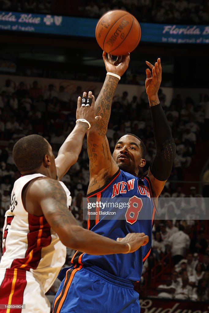 <a gi-track='captionPersonalityLinkClicked' href=/galleries/search?phrase=J.R.+Smith&family=editorial&specificpeople=201766 ng-click='$event.stopPropagation()'>J.R. Smith</a> #8 of the New York Knicks shoots against <a gi-track='captionPersonalityLinkClicked' href=/galleries/search?phrase=Mario+Chalmers&family=editorial&specificpeople=802115 ng-click='$event.stopPropagation()'>Mario Chalmers</a> #15 of the Miami Heat in Game One of the Eastern Conference Quarterfinals during the 2012 NBA Playoffs on April 28, 2012 at American Airlines Arena in Miami, Florida.