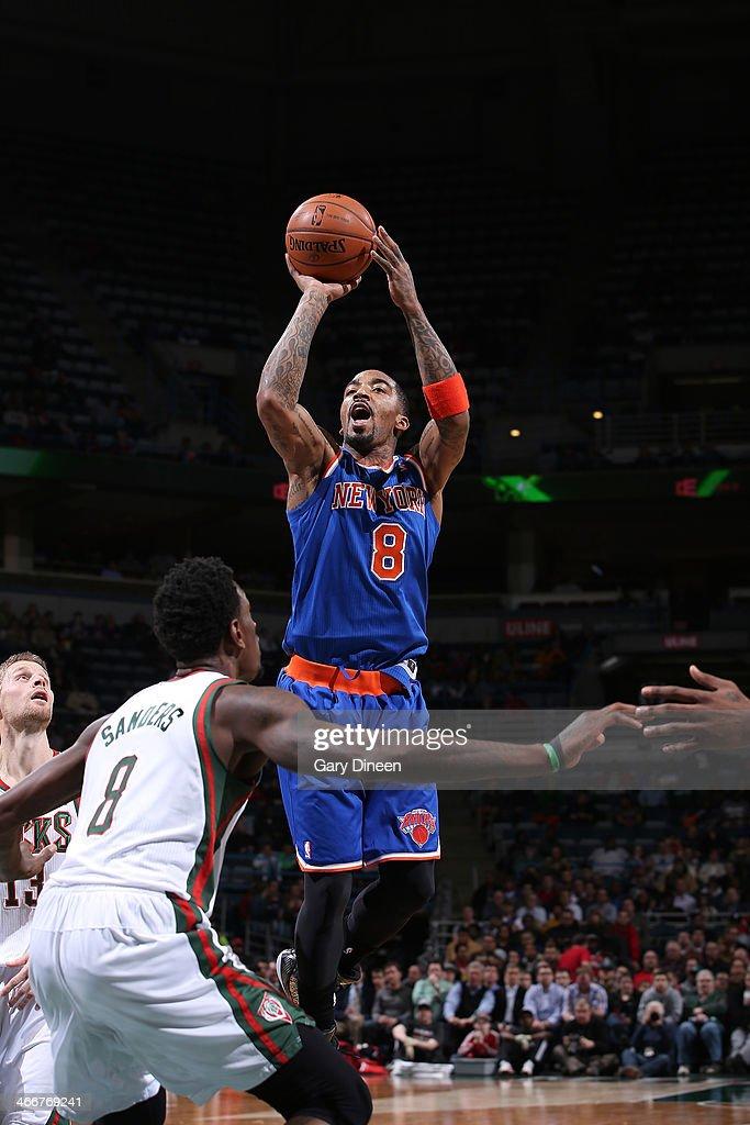 J.R. Smith #8 of the New York Knicks shoots against the Milwaukee Bucks on February 3, 2014 at the BMO Harris Bradley Center in Milwaukee, Wisconsin.