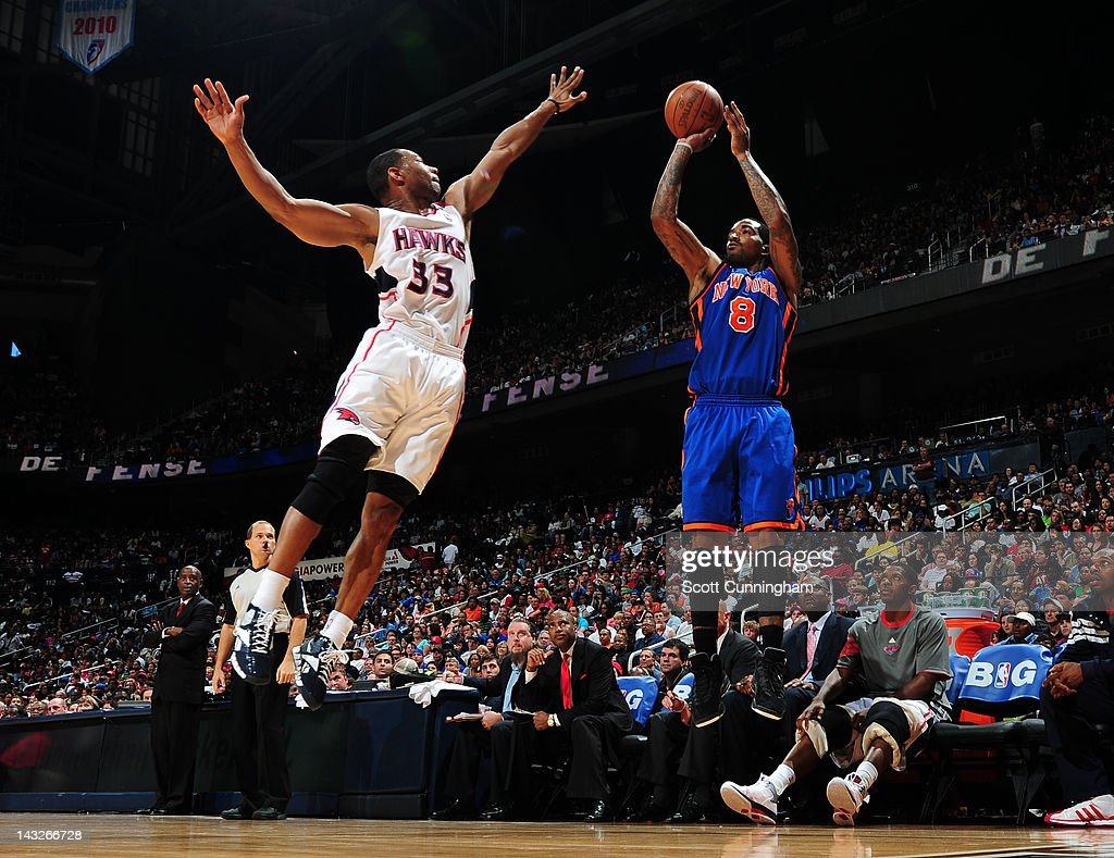 <a gi-track='captionPersonalityLinkClicked' href=/galleries/search?phrase=J.R.+Smith&family=editorial&specificpeople=201766 ng-click='$event.stopPropagation()'>J.R. Smith</a> #8 of the New York Knicks shoots against <a gi-track='captionPersonalityLinkClicked' href=/galleries/search?phrase=Willie+Green&family=editorial&specificpeople=201653 ng-click='$event.stopPropagation()'>Willie Green</a> #33 of the Atlanta Hawks on April 22, 2012 at Philips Arena in Atlanta, Georgia.
