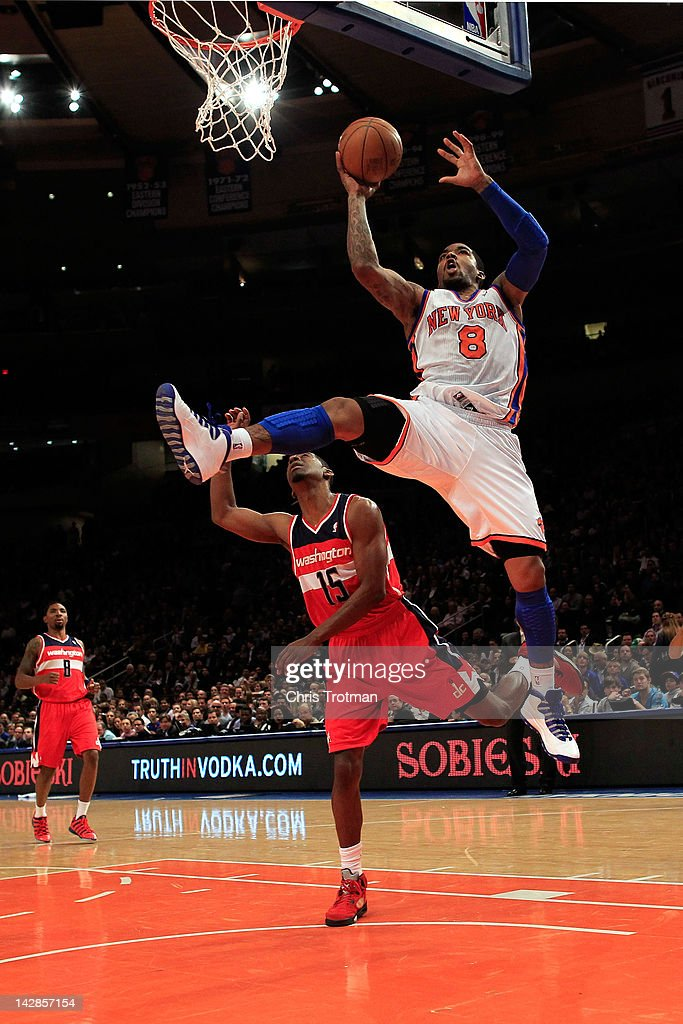 <a gi-track='captionPersonalityLinkClicked' href=/galleries/search?phrase=J.R.+Smith&family=editorial&specificpeople=201766 ng-click='$event.stopPropagation()'>J.R. Smith</a> #8 of the New York Knicks shoots over <a gi-track='captionPersonalityLinkClicked' href=/galleries/search?phrase=Jordan+Crawford&family=editorial&specificpeople=4779380 ng-click='$event.stopPropagation()'>Jordan Crawford</a> #15 of the Washington Wizards at Madison Square Garden on April 13, 2012 in New York City.