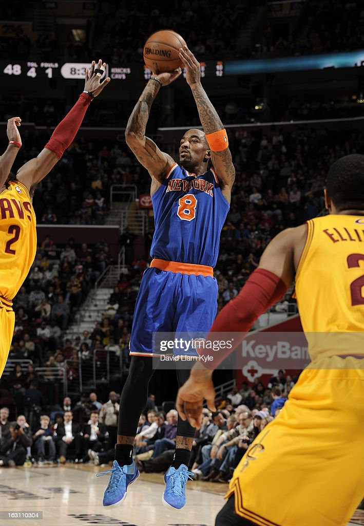 J.R. Smith #8 of the New York Knicks shoots over Kyrie Irving #2 of the Cleveland Cavaliers at The Quicken Loans Arena on March 4, 2013 in Cleveland, Ohio.