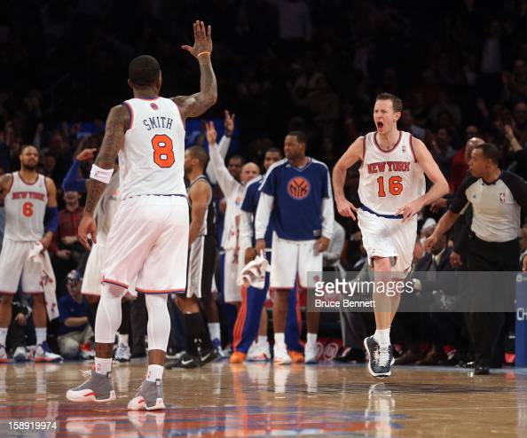 R Smith of the New York Knicks slautes teammate Steve Novak after his fourth quarter basket against the San Antonio Spurs at Madison Square Garden on...