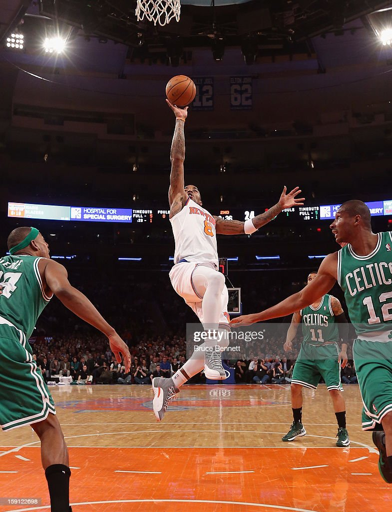 J.R. Smith #8 of the New York Knicks takes the shot against the Boston Celtics at Madison Square Garden on January 7, 2013 in New York City.