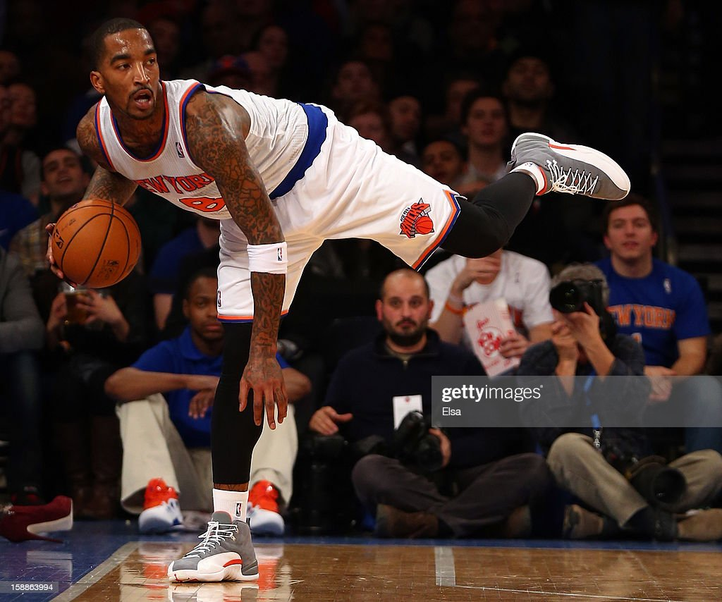 J.R. Smith #8 of the New York Knicks tries to keep the ball in bounds in the fourth quarter against the Portland Trail Blazers on January 1, 2013 at Madison Square Garden in New York City. The Portland Trail Blazers defeated the New York Knicks 105-100.