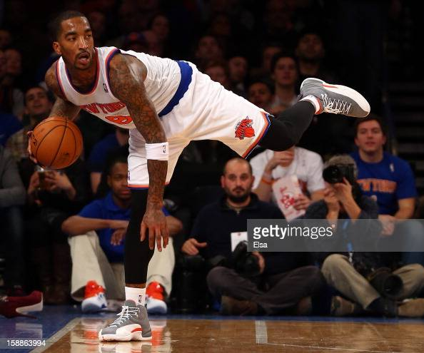 R Smith of the New York Knicks tries to keep the ball in bounds in the fourth quarter against the Portland Trail Blazers on January 1 2013 at Madison...