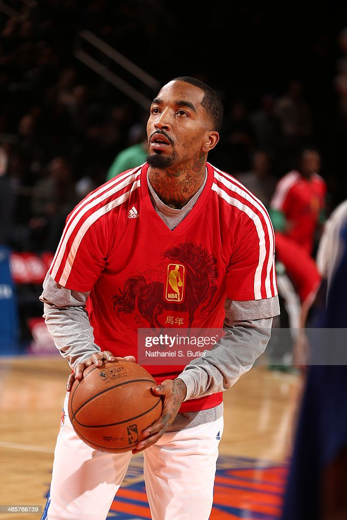 <a gi-track='captionPersonalityLinkClicked' href=/galleries/search?phrase=J.R.+Smith&family=editorial&specificpeople=201766 ng-click='$event.stopPropagation()'>J.R. Smith</a> #8 of the New York Knicks warms up before the game against the Boston Celtics at Madison Square Garden in New York City on January 28, 2014.