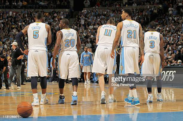 R Smith Raymond Felton Chris Andersen Wilson Chandler and Ty Lawson of the Denver Nuggets head to the bench during a time out against the Oklahoma...